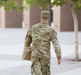 Soldier Walking with Books